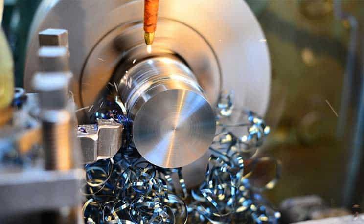 Professional machinist. Horizontal shot of a man operating lathe grinding machine metalworking industry