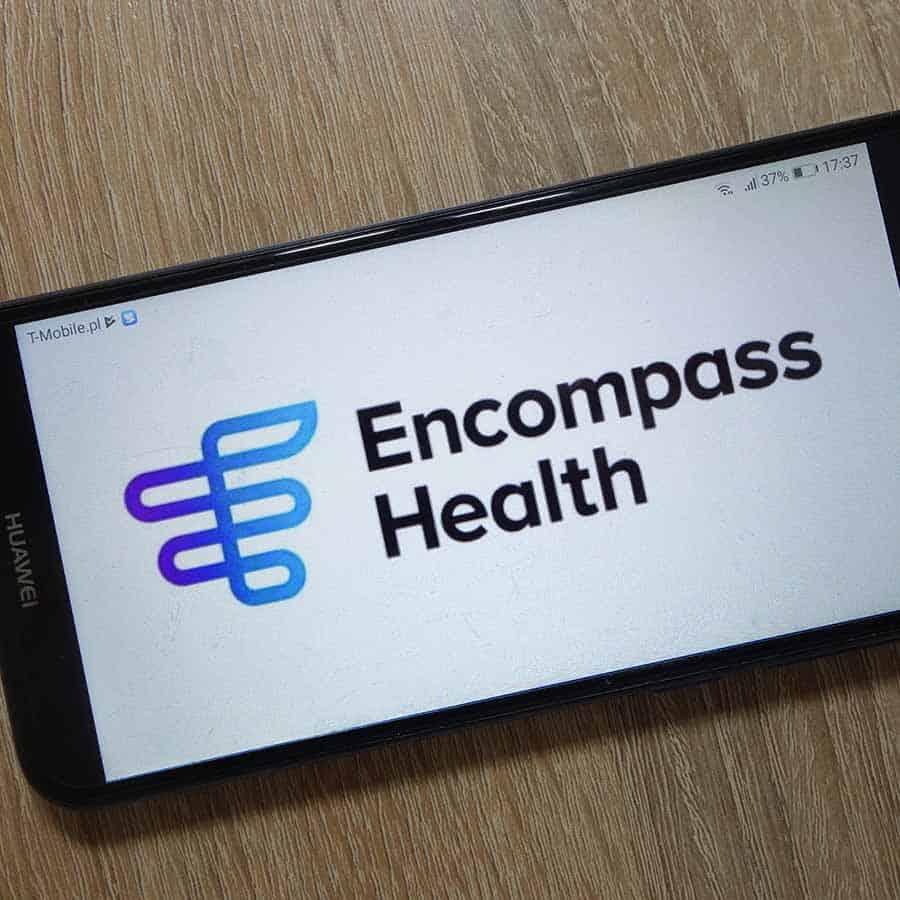 Encompass Health Corporation logo displayed on smartphone