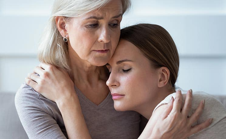 Older Woman Consoling Younger Woman
