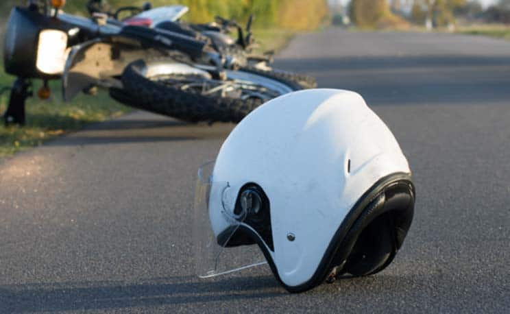 motorcycle helmet lying in the street following accident