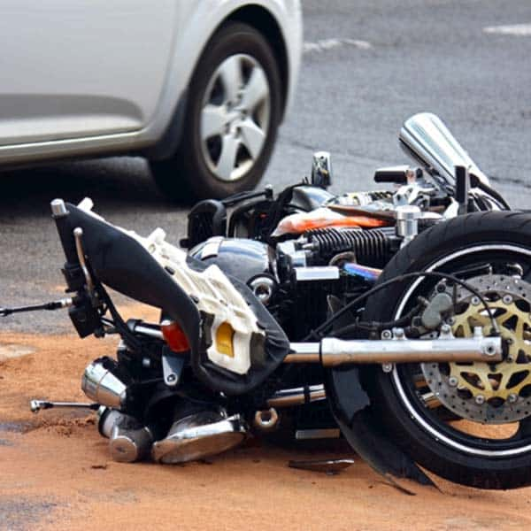 motorcycle lying in the street after accident